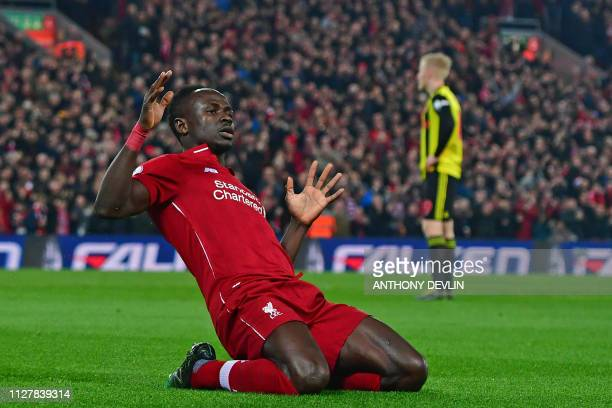 Liverpool's Senegalese striker Sadio Mane celebrates after scoring the opening goal of the English Premier League football match between Liverpool...