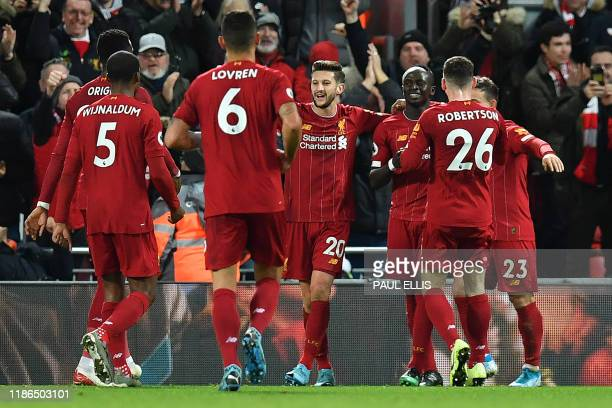 Liverpool's Senegalese striker Sadio Mane celebrates scoring his team's fourth goal during the English Premier League football match between...
