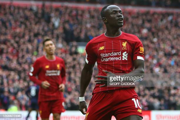 Liverpool's Senegalese striker Sadio Mane celebrates scoring his team's second goal during the English Premier League football match between...
