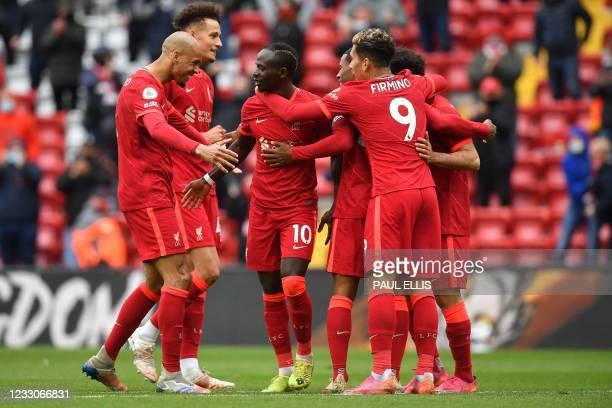 Liverpool's Senegalese striker Sadio Mane celebrates scoring his team's second goal during the English Premier League football match between...