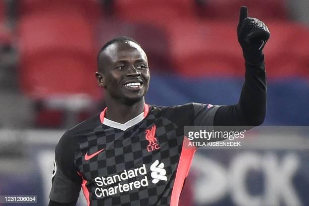 Liverpool's Senegalese striker Sadio Mane celebrates scoring the 0-2 goal during the UEFA Champions League round of 16 first leg football match...