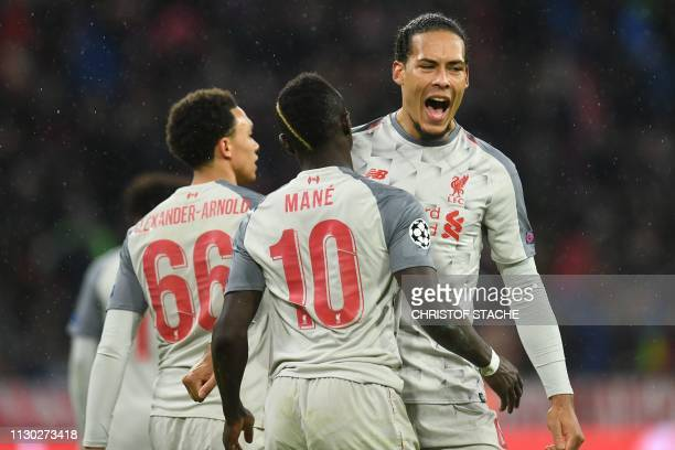 Liverpool's Senegalese striker Sadio Mane celebrates scoring the 13 goal with Liverpool's Dutch defender Virgil van Dijk and Liverpool's English...