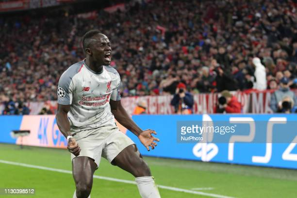Liverpool's Senegalese striker Sadio Mane celebrates scoring the opening goal during the UEFA Champions League last 16 second leg football match...