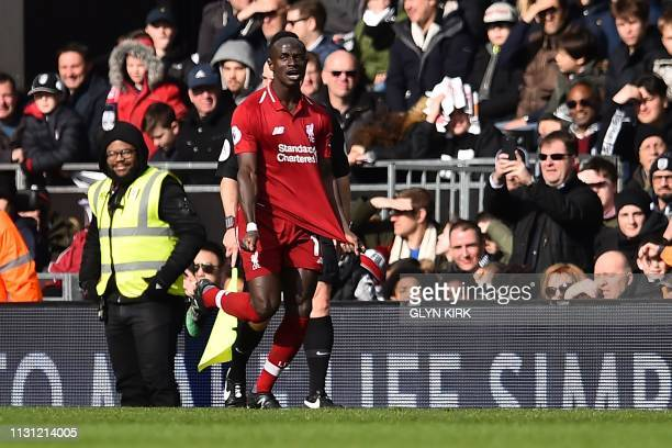 Liverpool's Senegalese striker Sadio Mane celebrates scoring the team's first goal during the English Premier League football match between Fulham...