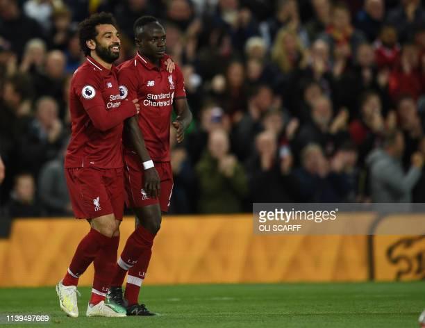 Liverpool's Senegalese striker Sadio Mane celebrates scoring with Liverpool's Egyptian midfielder Mohamed Salah during the English Premier League...