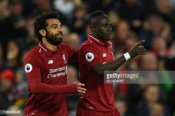 Liverpool's Senegalese striker Sadio Mane celebrates with Liverpool's Egyptian midfielder Mohamed Salah after scoring the team's second goal during...