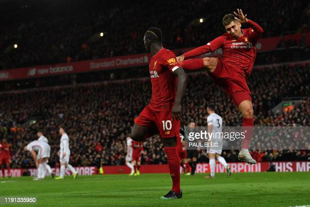 Liverpool's Senegalese striker Sadio Mane celebrates with Liverpool's Brazilian midfielder Roberto Firmino after he scores his team's second goal...