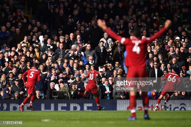 Liverpool's Senegalese striker Sadio Mane celebrates with teammates after scoring the team's first goal during the English Premier League football...
