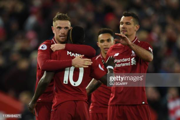 Liverpool's Senegalese striker Sadio Mane celebrates with teammates after he scores the team's fourth goal during the English Premier League football...