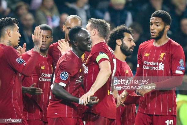 Liverpool's Senegalese striker Sadio Mane celebrates with teammates after scoring a goal during the UEFA Champions League Group E football match...