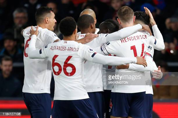 Liverpool's Senegalese striker Sadio Mane celebrates with teammates after scoring the opening goal of the English Premier League football match...