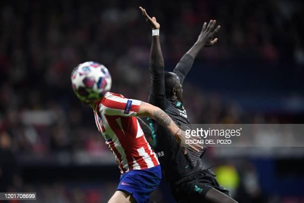 Liverpool's Senegalese striker Sadio Mane challenges Atletico Madrid's Croatian defender Sime Vrsaljko during the UEFA Champions League, round of 16,...