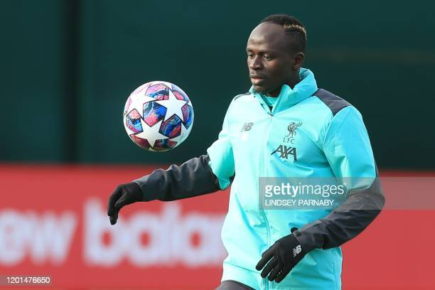 Liverpool's Senegalese striker Sadio Mane controls the ball during a training session at Melwood in Liverpool north west England on February 17 on...