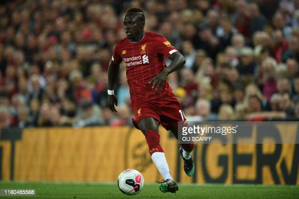 Liverpool's Senegalese striker Sadio Mane controls the ball during the English Premier League football match between Liverpool and Norwich City at...