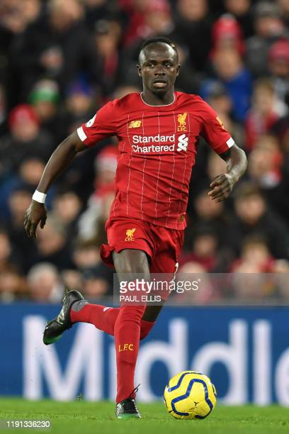 Liverpool's Senegalese striker Sadio Mane controls the ball during the English Premier League football match between Liverpool and Sheffield United...