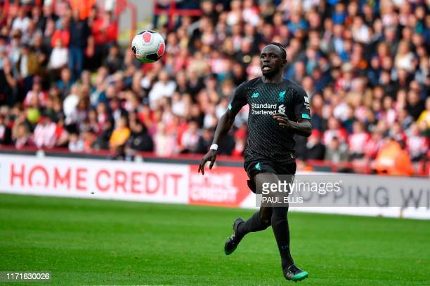 Liverpool's Senegalese striker Sadio Mane eyes a through ball during the English Premier League football match between Sheffield United and Liverpool...