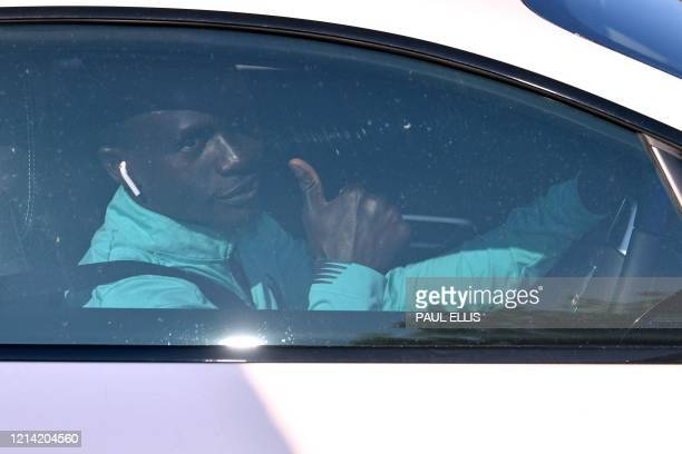 Liverpool's Senegalese striker Sadio Mane gestures as he leaves from Liverpool's training ground at Melwood in Liverpool north west England on May 20...