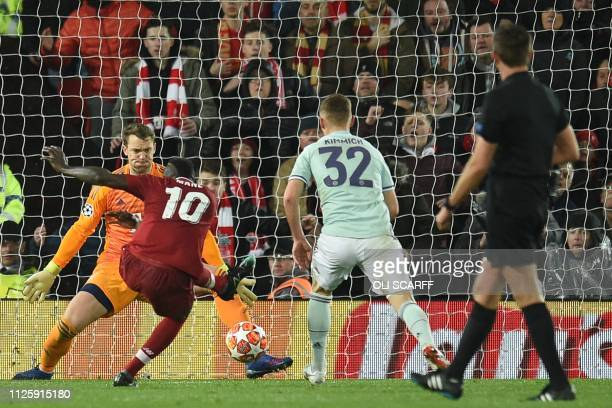 Liverpool's Senegalese striker Sadio Mane has an unsuccessful shot during the UEFA Champions League round of 16 first leg football match between...