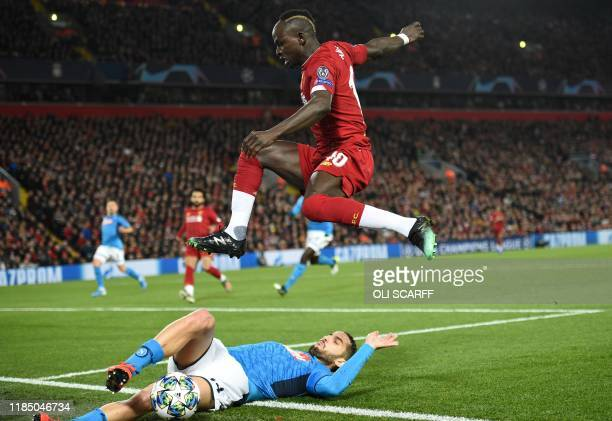Liverpool's Senegalese striker Sadio Mane hurdles Napoli's Belgian forward Dries Mertens during the UEFA Champions league Group E football match...
