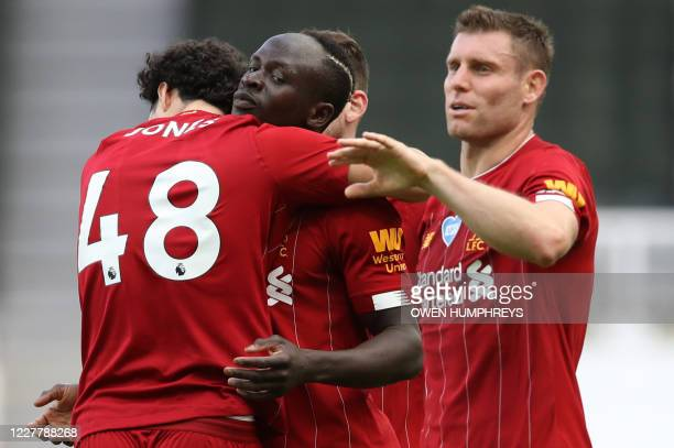 Liverpool's Senegalese striker Sadio Mane is congratulated by teammates after scoring a goal during the English Premier League football match between...