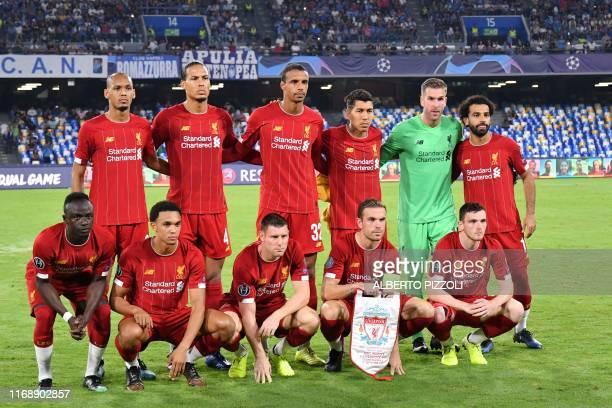 Liverpool's Senegalese striker Sadio Mane, Liverpool's English defender Trent Alexander-Arnold, Liverpool's English midfielder James Milner,...