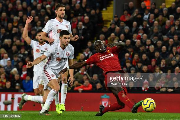 Liverpool's Senegalese striker Sadio Mane makes a shot which rebounds during the English Premier League football match between Liverpool and...