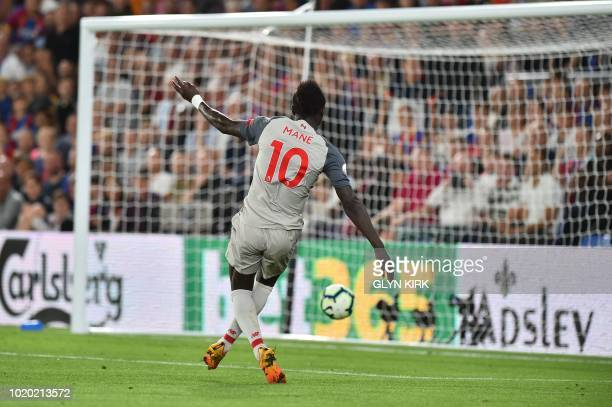 Liverpool's Senegalese striker Sadio Mane puts the ball into the open net after beating Crystal Palace's Welsh goalkeeper Wayne Hennessey to score...