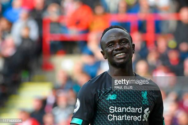 Liverpool's Senegalese striker Sadio Mane reacts after missing a chance during the English Premier League football match between Sheffield United and...