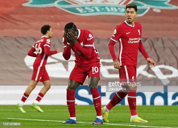 Liverpool's Senegalese striker Sadio Mane reacts after missing a chance during the English Premier League football match between Liverpool and...
