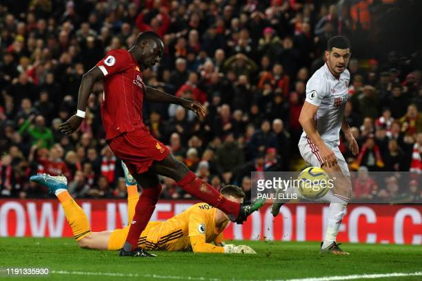 Liverpool's Senegalese striker Sadio Mane scores his team's second goal during the English Premier League football match between Liverpool and...
