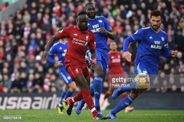 Liverpool's Senegalese striker Sadio Mane scores their fourth goal during the English Premier League football match between Liverpool and Cardiff...