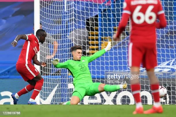 Liverpool's Senegalese striker Sadio Mane scores their second goal past Chelsea's Spanish goalkeeper Kepa Arrizabalaga during the English Premier...