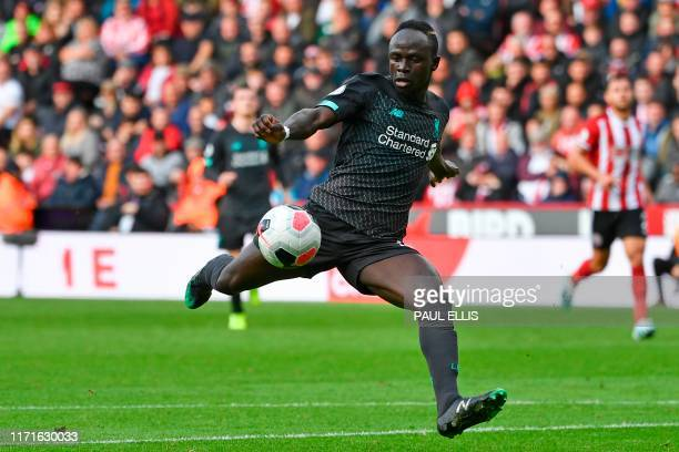 Liverpool's Senegalese striker Sadio Mane shoots but misses the target during the English Premier League football match between Sheffield United and...
