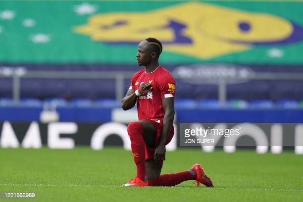 Liverpool's Senegalese striker Sadio Mane takes a knee to show solidarity with the Black Lives Matter movement against racism before kick off of the...