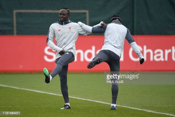 Liverpool's Senegalese striker Sadio Mane takes part in a team training session at Melwood in Liverpool north west England on April 16 on the eve of...