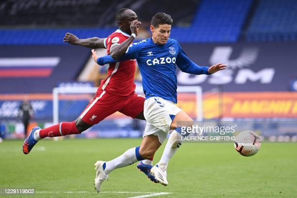 Liverpool's Senegalese striker Sadio Mane vies with Everton's Colombian midfielder James Rodriguez during the English Premier League football match...