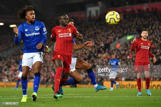 Liverpool's Senegalese striker Sadio Mane vies with Everton's Nigerian midfielder Alex Iwobi during the English Premier League football match between...