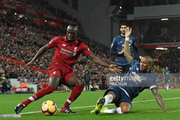 Liverpool's Senegalese striker Sadio Mane vies with Manchester United's English midfielder Ashley Young during the English Premier League football...
