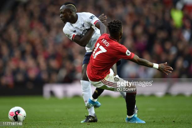 Liverpool's Senegalese striker Sadio Mane vies with Manchester United's Brazilian midfielder Fred during the English Premier League football match...