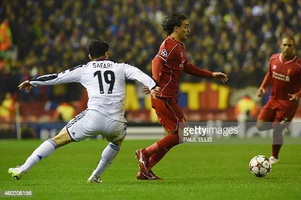 Liverpool's Serbian midfielder Lazar Markovic pulls away from Basel's Swedish defender Behrang Safari during the UEFA Champions League group B...