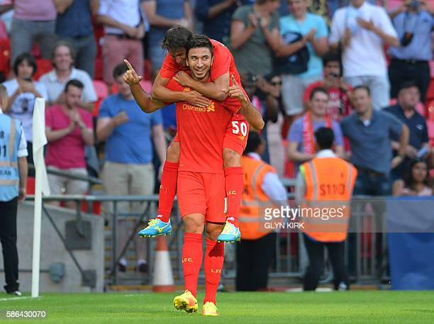 Liverpool's Serbian midfielder Marko Grujic celebrates with Liverpool's Serbian midfielder Lazar Markovic after scoring their fourth goal during the...