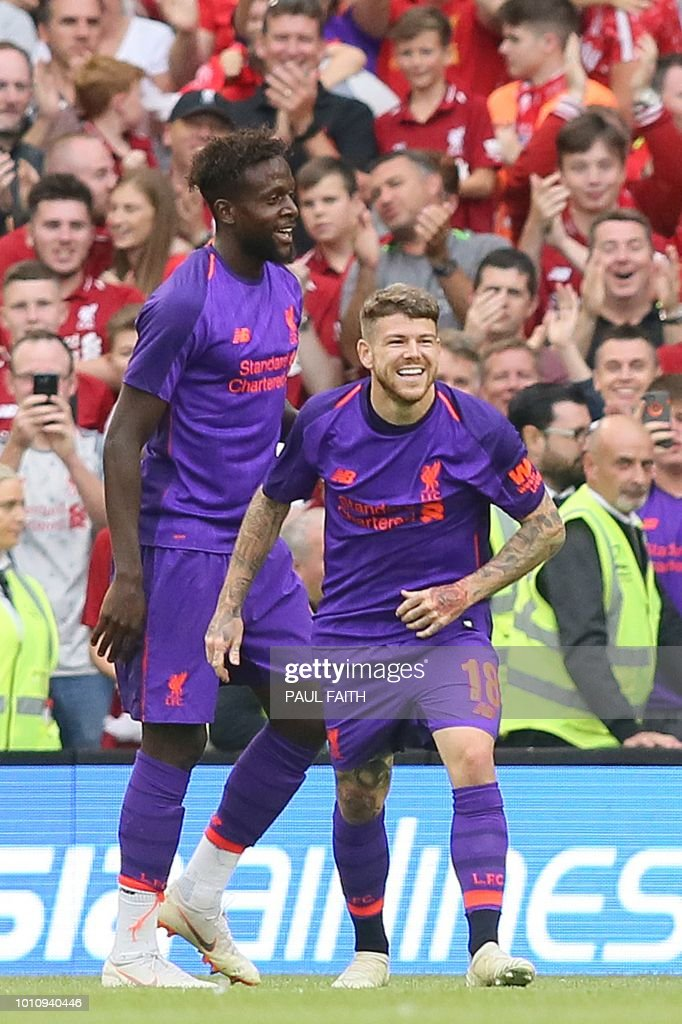 Liverpool's Spanish defender Alberto Moreno (R) celebrates scoring their fifth goal during the pre-season friendly football match between Liverpool and Napoli at the Aviva Stadimum in Dublin on August 4, 2018.