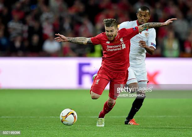 Liverpool's Spanish defender Alberto Moreno runs with the ball during the UEFA Europa League final football match between Liverpool FC and Sevilla FC...