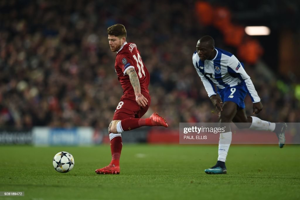 Liverpool's Spanish defender Alberto Moreno (L) vies with Porto's Cameroonian striker Vincent Aboubakar during the UEFA Champions League round of sixteen second leg football match between Liverpool and FC Porto at Anfield in Liverpool, north-west England on March 6, 2018. /