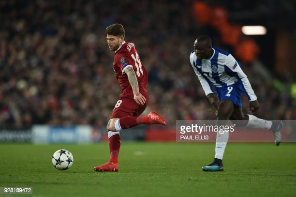 Liverpool's Spanish defender Alberto Moreno vies with Porto's Cameroonian striker Vincent Aboubakar during the UEFA Champions League round of sixteen...