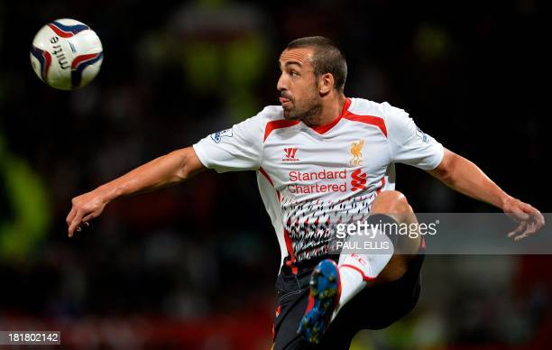 Liverpool's Spanish defender José Enrique controls the ball during the League Cup football match between Manchester United and Liverpool at Old...