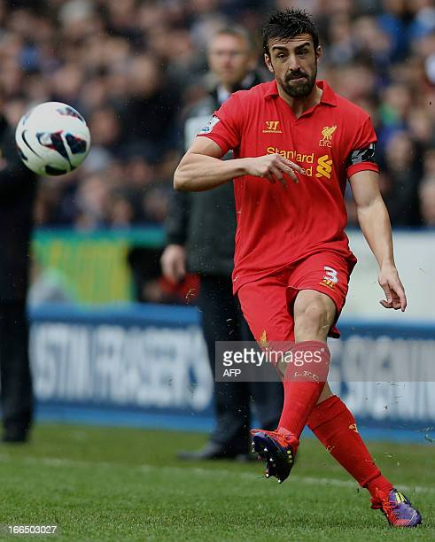 Liverpool's Spanish defender Jose Enrique crosses the ball during the English Premier League football match between Reading and Liverpool at The...