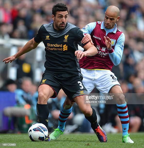 Liverpool's Spanish defender Jose Enrique vies with Aston Villa's Dutch-born Moroccan midfielder Karim El Ahmadi during the English Premier League...