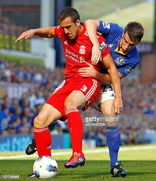 Liverpool's Spanish defender Jose Enrique vies with Everton's Irish defender Seamus Coleman during the English Premier League football match between...