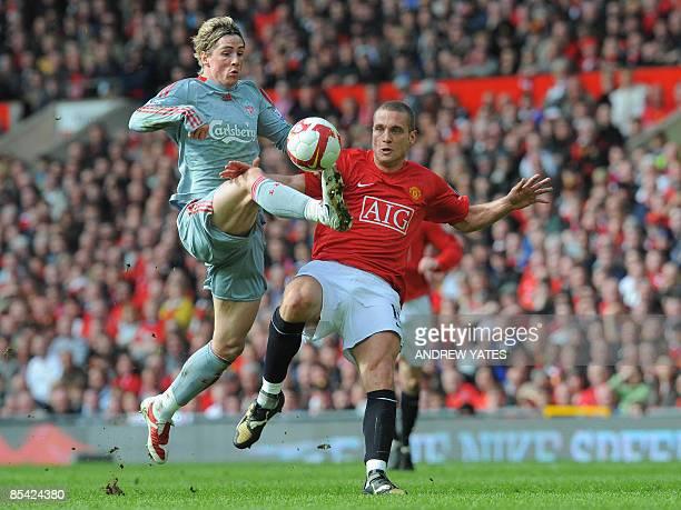 Liverpool's Spanish forward Fernando Torres beats Manchester United's Serbian defender Nemanja Vidic to score the equalising goal during their...
